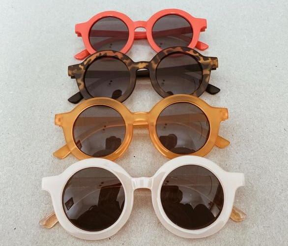 set of retro round sunglasses in red, tortoiseshell, mustard and blush
