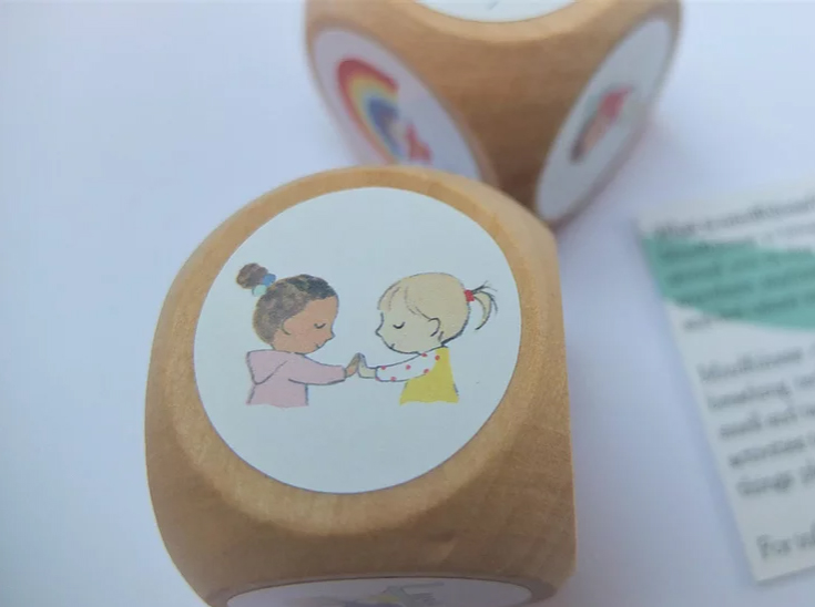 Wooden dice with illustrations of mindful actions