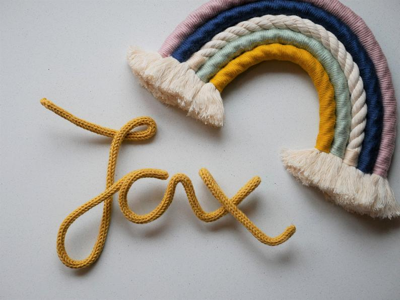 the name Jax made with a wired mustard rope in calligraphy or handwritten style
