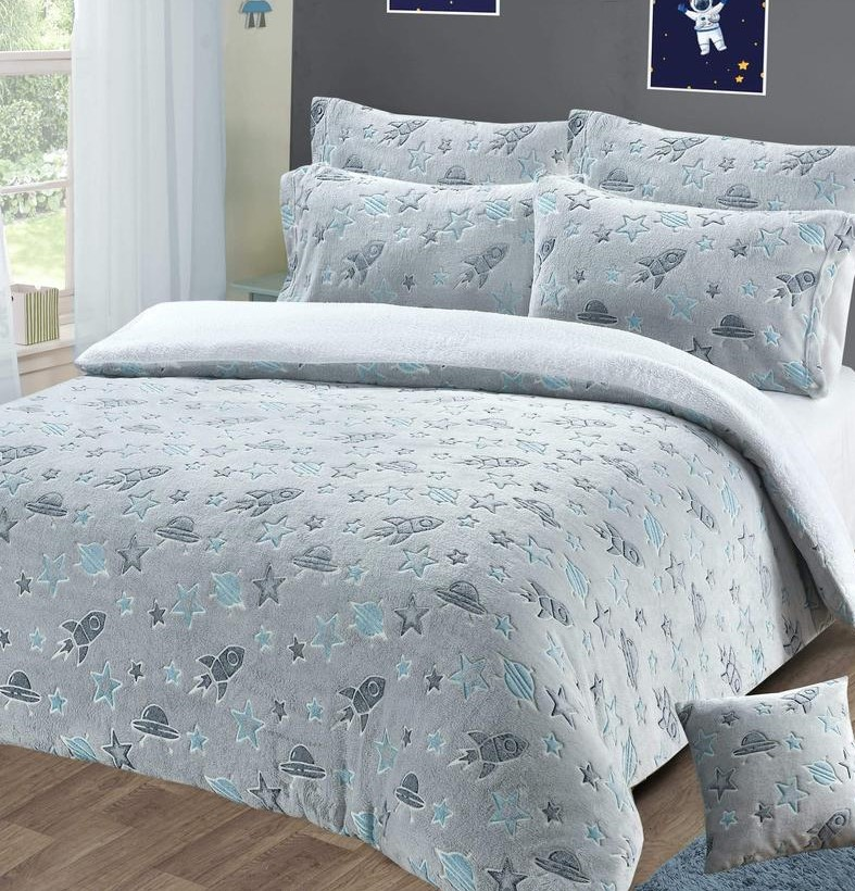 duvet set in pale grey with rocket star and ufo design which glows in the dark