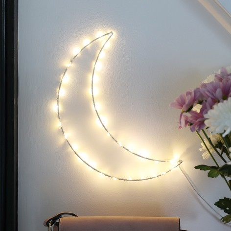 an LED lit crescent moon wall hanging