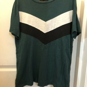 green tshirt with white and black chevron stripe across chest