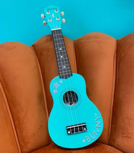 a bright aqua blue custom ukulele with personalisation's