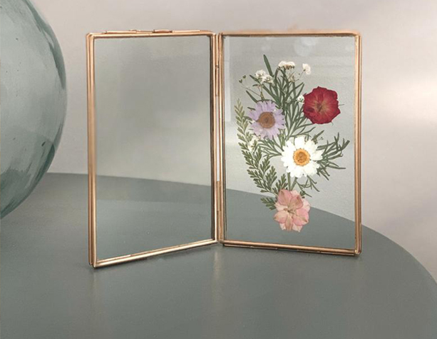 fold in the middle brass double frame with pressed flowers in one side