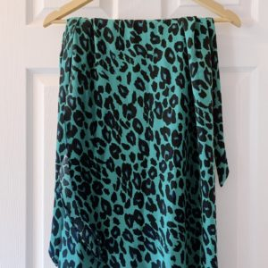 green leopard skirt hanging up