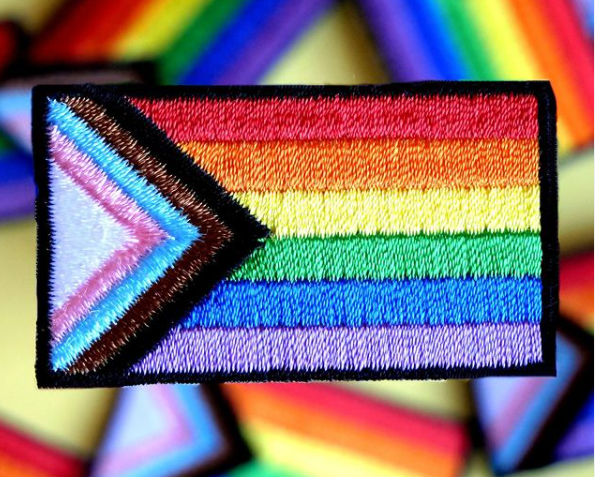 An embroidered patch of the new pride flag