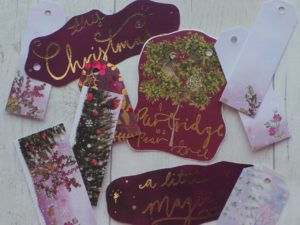 Christmas tags featuring traditional trees and plum colours