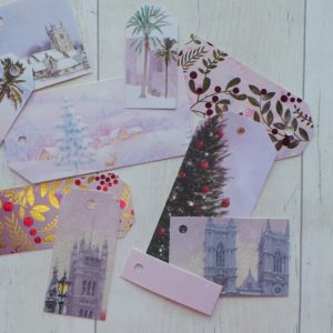 Traditional gift tags featuring churches and trees