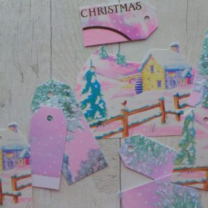 Bright pink gift tags with snowy houses