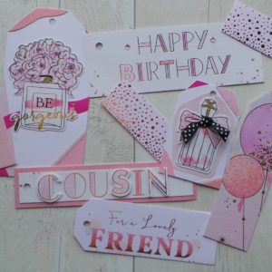 Selection of pink gift tags featuring perfume bottles and balloons
