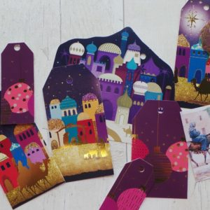 Bright purple colourful tags featuring baubles and the three wise men