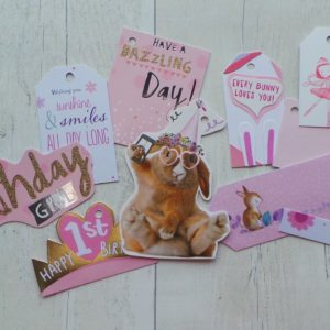 Set of gift tags featuring pink colours and bunnies, one for a 1st birthday and a birthday girl
