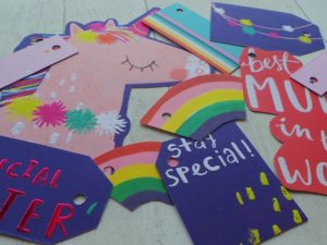 Selection of bright and rainbow themed tags featuring a unicorn