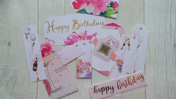 Selection of pink gift tags featuring a gin glass and perfume bottle