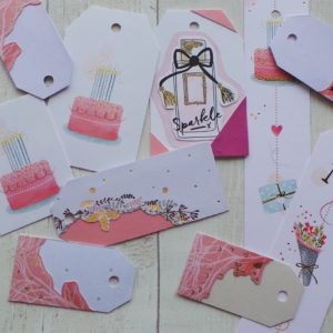 Selection of pastel colour gift tags featuring cakes and champagne bottles