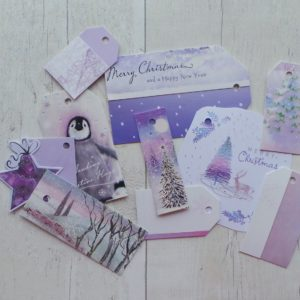 Lilac gift tags featuring a penguin, trees and snowy scenes