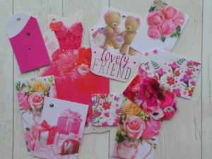 Selection of brightly coloured pink and floral gift tags in full bloom