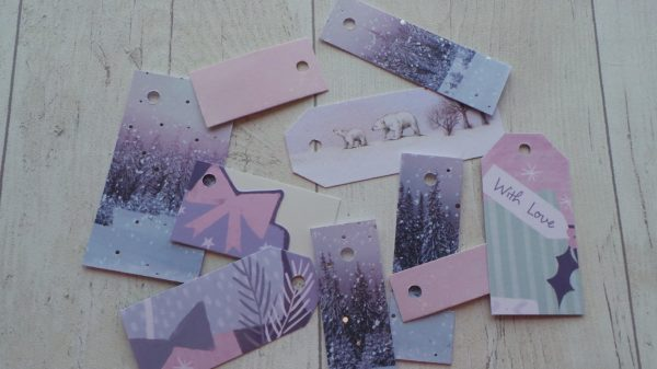Selection of pastel gift tags featuring presents and polar bears