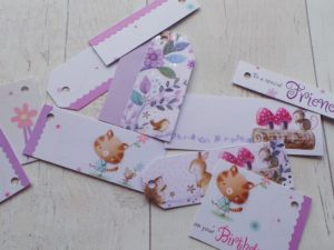 A selection of lilac gift tags featuring small creatures