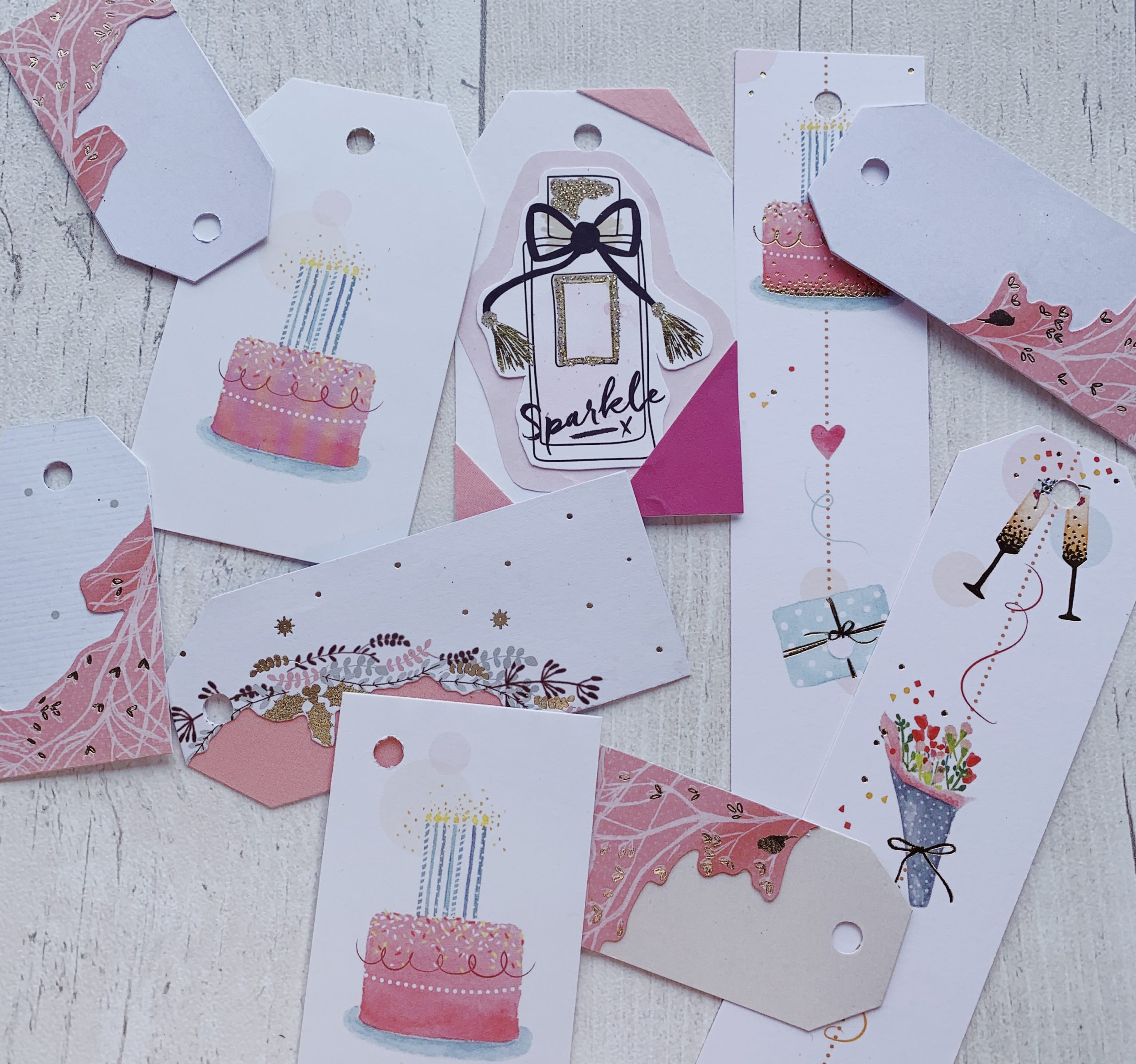 Selection of gift tags with cakes and perfume bottles