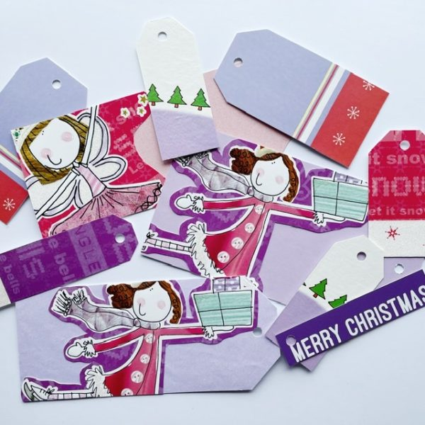 little girls and a fairy sharing gifts in purple and pinks