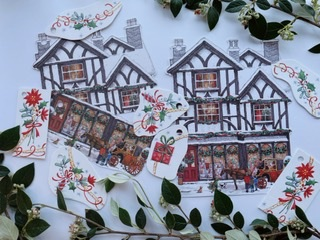 Some traditional shops looking Christmassy - large tags, and some small tags made from sections of card with traditional decorations on like ribbons and holly.
