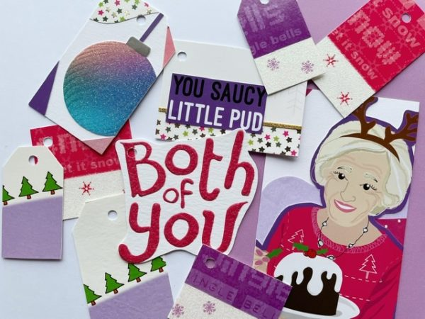 Tags including Mary b holding a pud, lots of purple and glitter in this fun pack