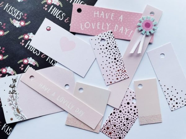 Pastel pink tags with hearts, dots and glitter