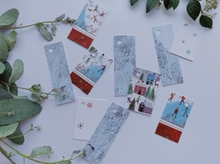 Selection of gift tags with red Christmas trim and skaters ice skating in a park. Also blue tree textures tags. Pretty blue and red theme.