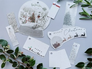 Lovely grey toned tags with minimal red details such as a small stripe, and tree baubles within the snow globe tag. Other tags are Christmas trees, white glitter and Santa's sleigh over the moon in greys and silvers.