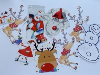 Selection of cartoon style tags, one is a snowman drawn by a child! Lots of reindeer, a Santa and some snowmen.