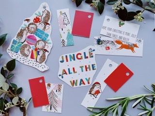 Cute and modern selection featuring hedgehogs with presents, a fox, some pastel colour trees. Also some white subtle spot tags which have red backs.