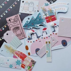 Gift tags including penguins in a camper!