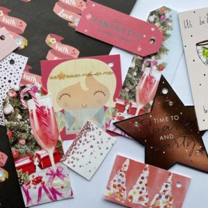 Coral and pink tags, featuring fizz, an angel, a star and trees