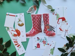 Red and green themed tags with lots on nice textured paper. A big pair of red wellies with a robin, and baubles hainging down across several tags. Also one white glitter tag with red stripe.