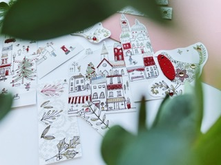 This tag selection is full of illustrated shops and people, black line drawing filled with bits of red and other colours. Also some birds who have fabric tummy's do some foliage.