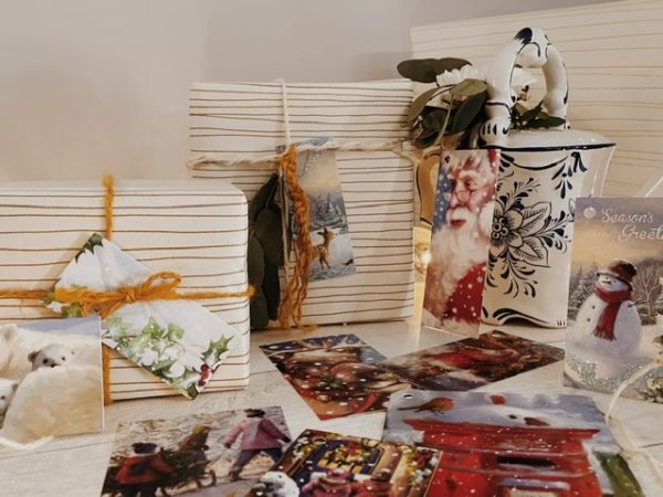 Selection of painted effect tradition style tags, they feature things like Santa, polar bears, a post box and sledge.