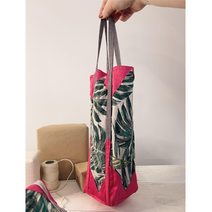 a hand holding an emma gift bag