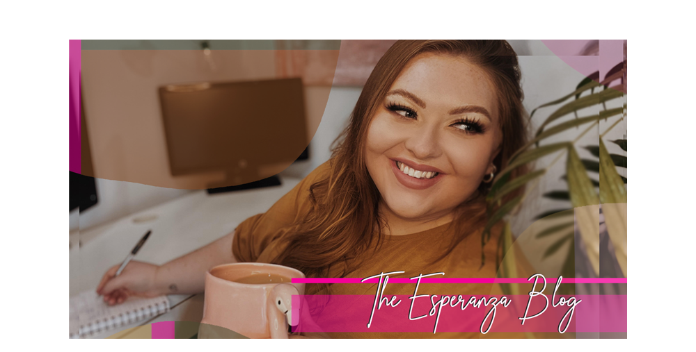 The Esperanza Blog - image of Abi Sat at her desk with a tea