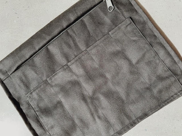 A custom made lining pouch for a bag made to hold an ipad and pens.
