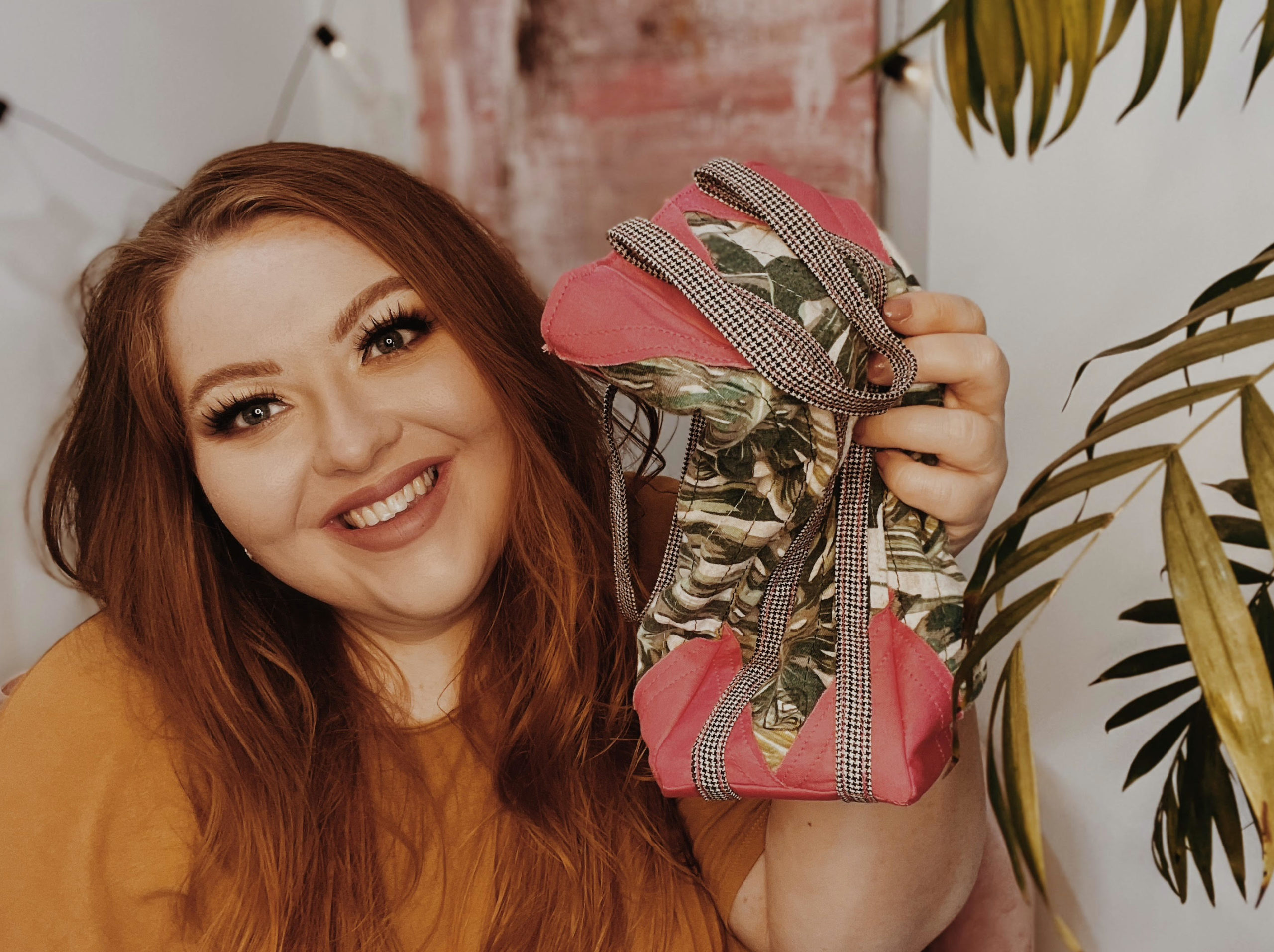 Image of Abi smiling as she holds up one of the Esperanza Wrap gift bags
