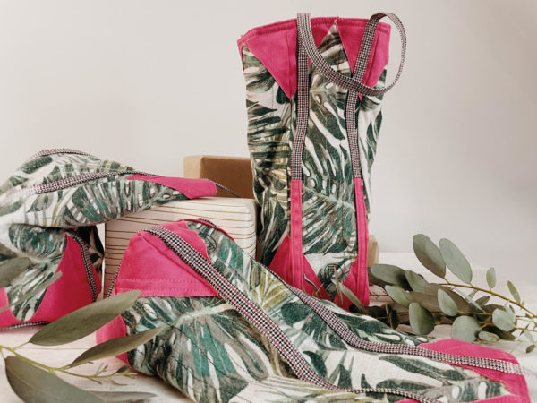 Fabric upcycled bottle bags with leaf green print and pink corners